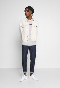 Tommy Jeans - TAPERED CARPENTER - Relaxed fit jeans - dark-blue denim - 1