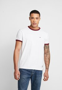 Tommy Jeans - SOLID RINGER TEE - T-shirt con stampa - white - 0