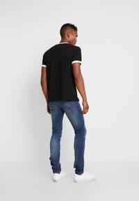 Tommy Jeans - RINGER LOGO TEE - Print T-shirt - black/classic white - 2