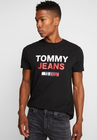 Tommy Jeans - LOGO TEE - T-shirt con stampa - black - 0