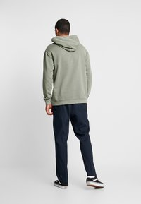 Tommy Jeans - GRAPHIC WASHED  - Mikina skapucí - green - 2