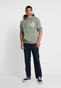 Tommy Jeans - GRAPHIC WASHED  - Mikina skapucí - green - 1