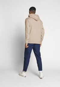 Tommy Jeans - CAMO HOODIE - Hoodie - stone - 2