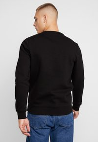 Tommy Jeans - NOVEL LOGO CREW - Felpa - black - 2