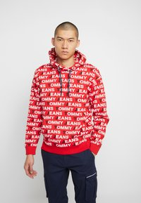 Tommy Jeans - ALL OVER HOODIE - Hoodie - racing red - 0