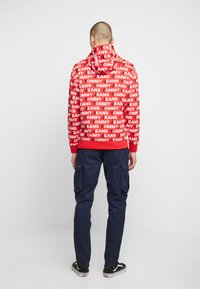 Tommy Jeans - ALL OVER HOODIE - Hoodie - racing red - 2