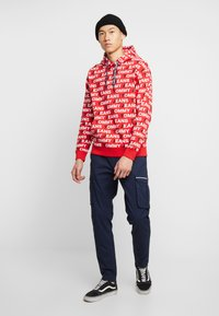 Tommy Jeans - ALL OVER HOODIE - Hoodie - racing red - 1
