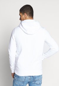 Tommy Jeans - TJM ESSENTIAL GRAPHIC HOODIE - Mikina skapucí - white - 2