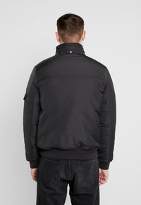 Tommy Jeans - TECH JACKET - Chaqueta de invierno - black - 4