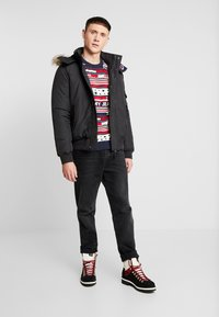 Tommy Jeans - TECH JACKET - Chaqueta de invierno - black - 1