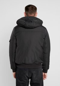 Tommy Jeans - TECH JACKET - Chaqueta de invierno - black