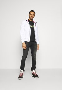 Tommy Jeans - ESSENTIAL JACKET - Summer jacket - white - 1