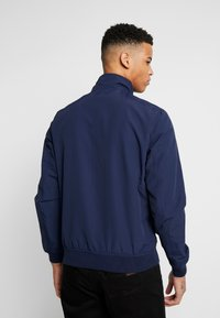 Tommy Jeans - ESSENTIAL JACKET - Lehká bunda - dark blue - 2
