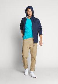 Tommy Jeans - ESSENTIAL HOODED JACKET - Summer jacket - black iris - 1