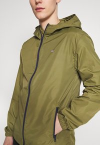 Tommy Jeans - PACKABLE - Vindjakke - uniform olive - 4