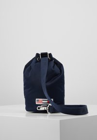 Tommy Jeans - HERITAGE SMALL SLING BAG - Handtas - blue