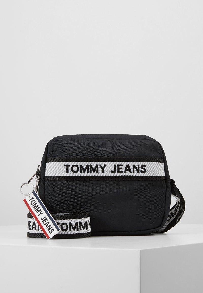 Tommy Jeans - LOGO TAPE CROSSOVER - Umhängetasche - black