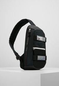 Tommy Jeans - URBAN SLING BAG - Skulderveske - black - 3