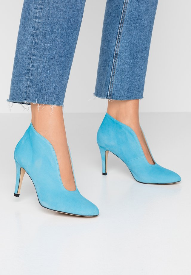 High heeled ankle boots - light blue