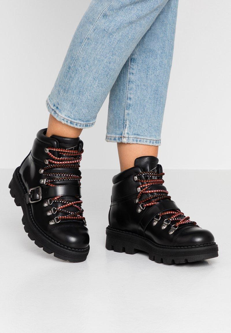 Toral - Kotníkové boty na platformě - black