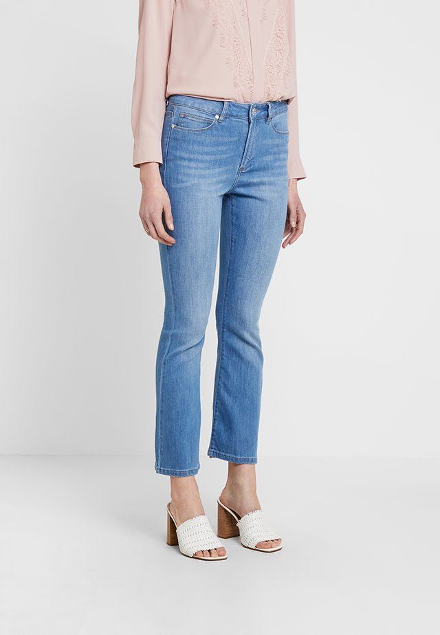 MALCOLM KICK  - Flared Jeans - denim blue
