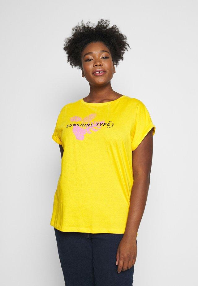 T-shirts med print - deep golden yellow