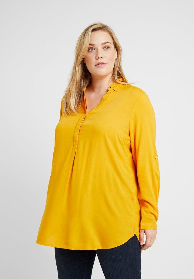 Tunikaer - merigold yellow
