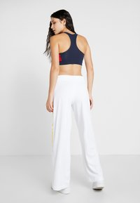 Tommy Sport - GRAPHIC CULOTTE PANTS - Tracksuit bottoms - white - 2