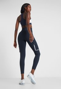 Tommy Sport - HIGHWAIST CARGO LEGGING - Tights - blue - 2