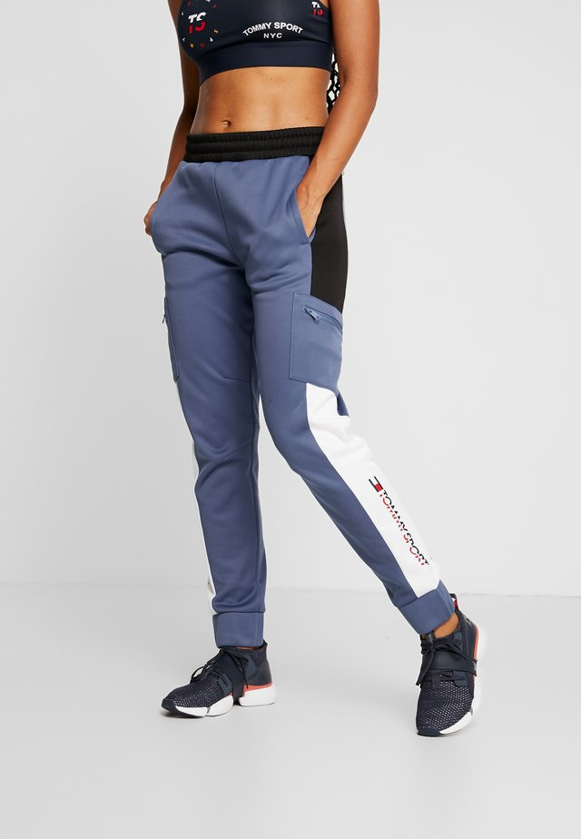 PANT - Träningsbyxor - blue