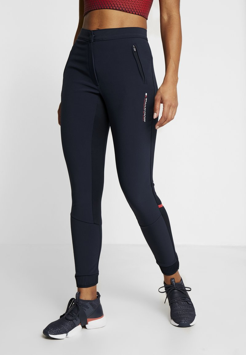Tommy Sport - TRAINING TAPERED PANT REFLECTIVE - Trainingsbroek - blue