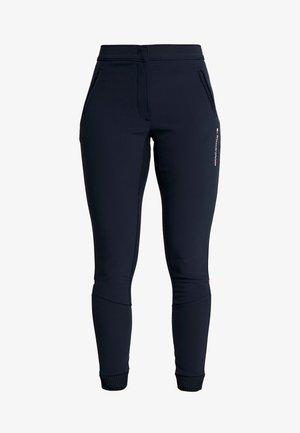 TRAINING TAPERED PANT REFLECTIVE - Pantalon de survêtement - blue