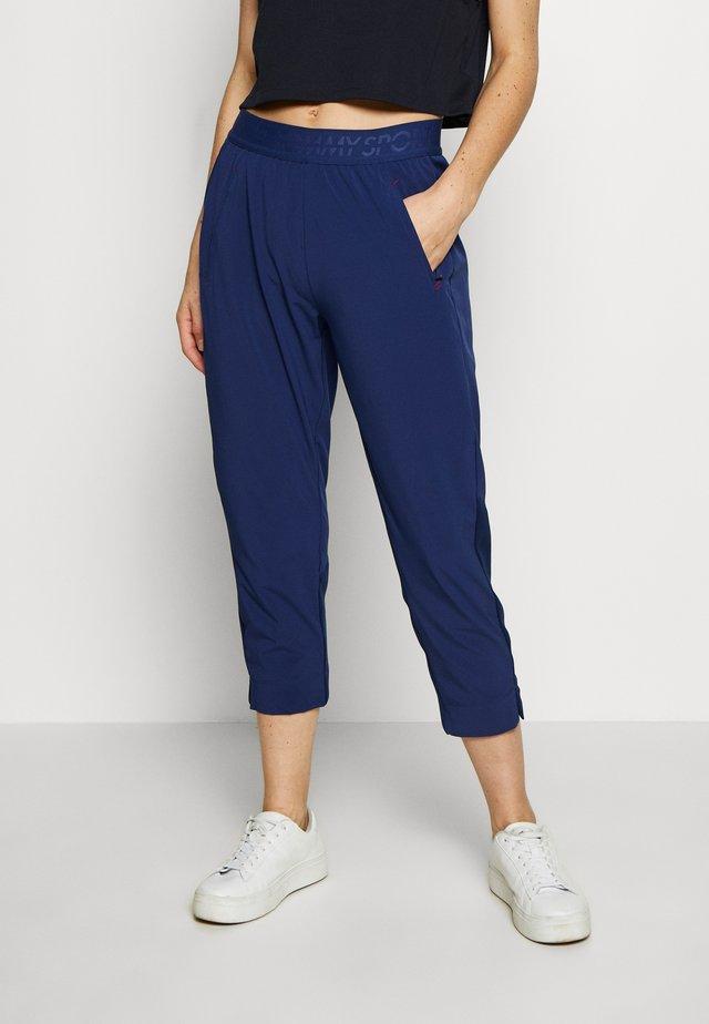 7/8 RUNNING TECH PANT - Teplákové kalhoty - blue
