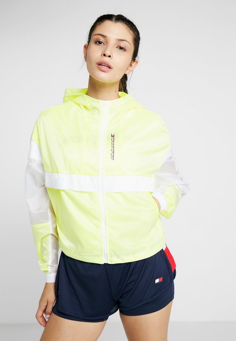 Tommy Sport - WITH TAPE - Veste coupe-vent - yellow