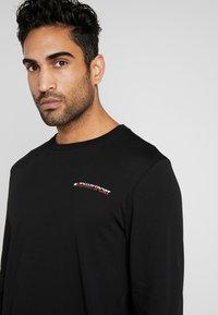Tommy Sport - LONG SLEEVE TEE - Sports shirt - black - 3