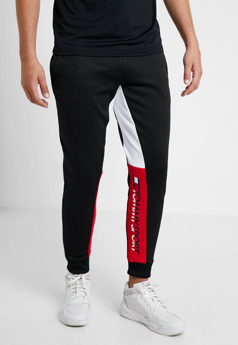 Tommy Sport - GRAPHIC LOGO CUFF - Pantalon de survêtement - black