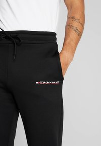 Tommy Sport - JOGGER LOGO - Tracksuit bottoms - black - 4