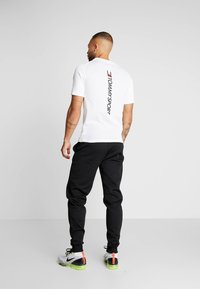 Tommy Sport - JOGGER LOGO - Tracksuit bottoms - black - 2
