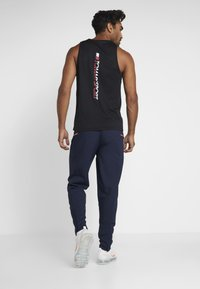 Tommy Sport - TAPE CLASSIC - Tracksuit bottoms - sport navy - 2