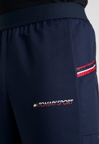 Tommy Sport - TAPE CLASSIC - Tracksuit bottoms - sport navy - 4