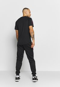 Tommy Sport - TAPE TRACK PANT - Tracksuit bottoms - black - 2