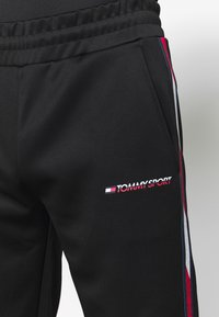 Tommy Sport - TAPE TRACK PANT - Tracksuit bottoms - black - 4