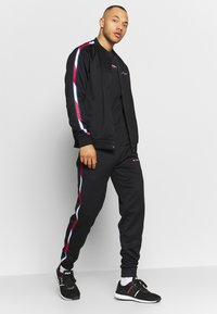 Tommy Sport - TAPE TRACK PANT - Tracksuit bottoms - black - 1