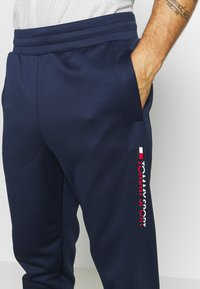 Tommy Sport - GLOW WINTERIZED TRAINING PANT - Trainingsbroek - blue - 4