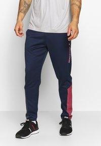 Tommy Sport - GLOW WINTERIZED TRAINING PANT - Trainingsbroek - blue - 0
