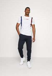 Tommy Sport - CUFF JOGGER LOGO - Tracksuit bottoms - blue - 1