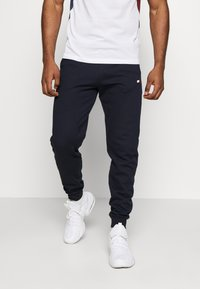 Tommy Sport - CUFF JOGGER LOGO - Tracksuit bottoms - blue - 0