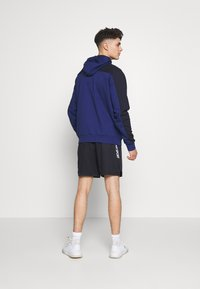 Tommy Sport - Sports shorts - blue - 2