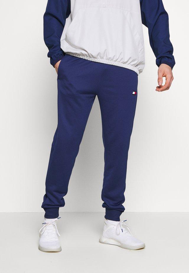 PRINTED CUFFED TRACK PANT - Spodnie treningowe - blue