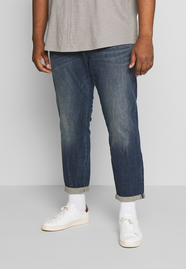 Slim fit jeans - mid stone wash denim